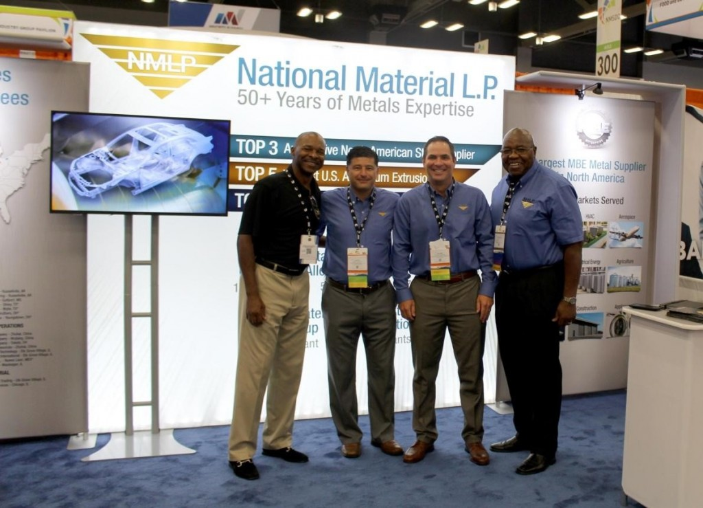 Members of the NMC team standing in front of their booth at the 2018 NMSDC conference