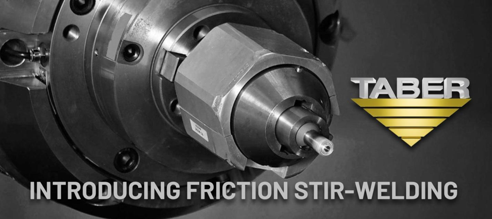 "Black and white closeup image of the tip of a friction stir-welder, which resembles the tip of a drill, with Taber Extrusions' official inverted gold triangle logo and the words, ""Introducing Friction Stir-Welding."""