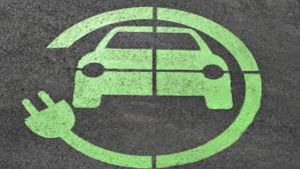 A symbol for an electric car with a green electrical cord and plug circling a green car.
