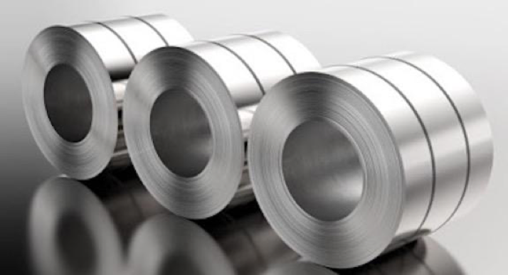 Three coils of steel in sleek silver tones uniformly on their sides with two bands holding each roll wound tightly and their reflections on the surface underneath them